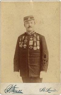 Portrait (three-quarters length, 4''x5.5'') of Gilmore in uniform with medals. Photograph by Strauss, 1245 and 1247 Franklin Avenue, St. Louis, 1889. This negative is preserved [by Strauss] for further use