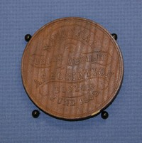 "Wooden medallion (2 3/8'' diam.) commemorating the National Peace Jubilee, Boston 1869. Front, bust of Gilmore, ""Projector of National Peace Jubilee;"" back, ""National Peace Jubilee Association, Boston, June 1869"""