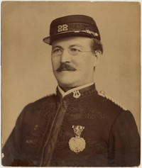 Portrait (chest 15''x20'') of Gilmore in uniform of 22nd Regiment Band, with one medal on chest. No photographer or date
