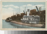 Glimpse of the C. & O. coal piers, loading whaleback barges, Newport News, Virginia, 1915-1930