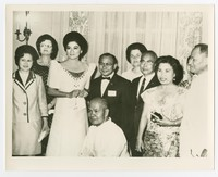 Imelda Marcos Poses with Guests (also in photo: Hlariona Piniera and Lady Bird Johnson), photograph taken by Leonardo Fuñe [Photograph, Black and White] [Notebook 2]
