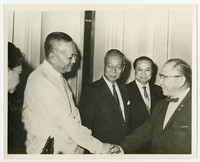 President Diosdado Macapagal greeting group of men [Photograph, Black and White] [Notebook 2]