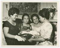 """Women Holding Silver Tray (inscribed """"To President and Mrs. Diosdado Macapagal on their State visit to the United States, Washington, D.C., October 6, 1964""""), includes Resurrecion Asuncion [Photograph, Black and White] [Notebook 2]"""