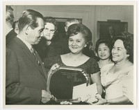"""Women Presenting Silver Tray (inscribed """"To President and Mrs. Diosdado Macapagal on their State visit to the United States, Washington, D.C., October 6, 1964""""), Resurrecion Asuncion (center), Ana Alcoy (2nd from right) [Photograph, Black and White] [Note"""