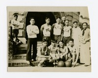 Mariano Peji and Filipino navy men posed in basketball uniforms [Photograph, Black and White] [Digital Only]