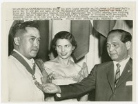 Colonel Jesus Villamor receiving medal for valor and the distinguished conduct star from visiting President Carlos Garcia, Washington, D.C. [Photograph, Black and White] [Digital Only]
