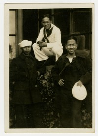 Mariano Peji posing with US Navy sailors [Photograph, Black and White] [Digital Only]
