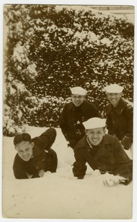 Mariano Peji and US Navy sailors running through snow [Photograph, Black and White] [Digital Only]