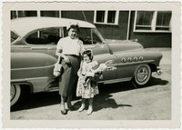 Fermina Santos Peji and Nila Toribio-Straka in front of a car in the 1950s [Photograph, Black and White] [Digital Only]