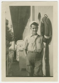 Leo C. Toribio in US naval uniform onboard the USS Cape Esperance, Cue 88 [Photograph, Black and White] [Digital Only]