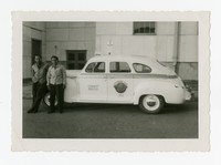 Clemente Cacas with Moises Bautista and his Taxicab [Photograph, Black and White] [Notebook 1]