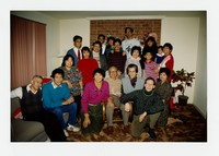 Extended Cacas Family Christmas Photo - with Bello family, Undayag and Comiso families, Gonzales family, Cacas Myers and Cacas Cook families at Emily and Nilo Gonzales' house [Photograph, Color] [Notebook 1]