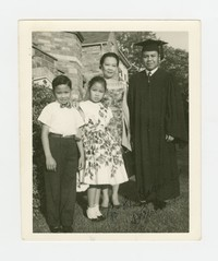 Alex DePeralta with his Family at his Graduation from Southeastern University [Photograph, Black and White] [Notebook 1]