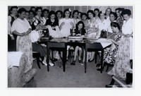 "Group of Filipino Women Sewing, including Asuncion ""Manang"" Gaudiel, Leona Sevilla, Juliana Panganiban, Consuelo Perez, and Mrs. Jaime Hernandez [Photograph, Black and White] [Notebook 1], Undated"