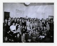 Philippine Resident Commissioner's Office Staff, including Vangie Paredes (back row under wall lamp) [Photograph, Black and White] [Notebook 1], Late 1930s