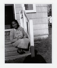 Felixberta Quidangen on Steps of Her House on Chesapeake Street in southeast Washington, D.C. [Photograph, Black and White] [Notebook 1], Undated