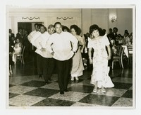 Ruben Curameng, Rose Curameng (front row) and Alex DePeralta and Florentina DePeralta (second row) in Traditional Filipino Dress Dancing [Photograph, Black and White] [Notebook 2], Circa 1966