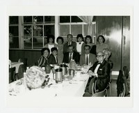 Friends Gathering After Sharing a Meal Together, Including Kay Fuñe (standing first on left), Leonardo Fuñe (seated 4th from left) and Felix Piniera (seated 1st on right) [Photograph, Black and White] [Notebook 2], Undated
