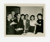 Eight Individuals around Table with Food [Photograph, Black and White] [Notebook 2], Circa 1945-1950