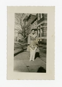 Mother (Julie Panganiban) with Child (Lena Panganiban) on Sidewalk [Photograph, Black and White] [Notebook 2], February 16, 1948