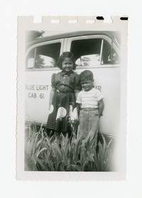 Lena Panganiban and Benny Puyot in Front of Cab [Photograph, Black and White] [Notebook 2], Circa 1956