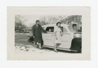 Man, Leona Puyot and Child with Cab [Photograph, Black and White] [Notebook 2], Circa 1945-1950