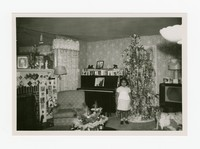 Lena Panganiban at the Calabia's House in Northeast Washington, D.C. at Christmas Time [Photograph, Black and White] [Notebook 2], December 1955