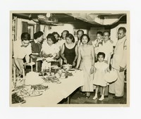 Group Gathering with Food [Photograph, Black and White] [Notebook 2], December 1943