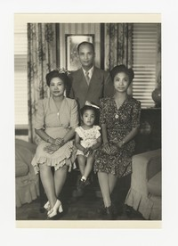 Rudy Panganiban, Julie Panganiban, Leona Puyot and Mina Puyot at Mrs. Calabia's House in Northeast Washington, D.C. [Photograph, Black and White] [Notebook 2], July 1, 1945