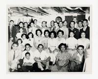 Leona Puyot and Mina Puyot with group at a celebration [Photograph, Black and White] [Notebook 2], circa 1955-1960