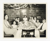 Group of Mostly Children Around Table at Dinner [Photograph, Black and White] [Notebook 2], circa 1955-1960