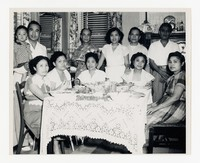 Group Photo (including Leona Puyot) around table [Photograph, Black and White] [Notebook 2], circa 1950-1960