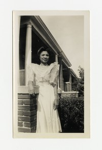 Leona Puyot Outside of a House [Photograph, Black and White] [Notebook 2], circa 1940-1960