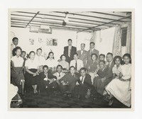 Mina Puyot with Group [Photograph, Black and White] [Notebook 2], circa 1950-1960
