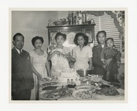 Leona Puyot with a Small Group at a Celebration [Photograph, Black and White] [Notebook 2], circa 1950-1960