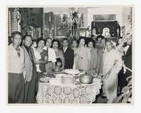Leona Puyot with Large Group Around Table [Photograph, Black and White] [Notebook 2], circa 1950-1960
