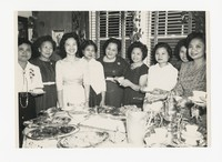 Mina Puyot with Group of Women Around Table [Photograph, Black and White] [Notebook 2], circa 1950-1960