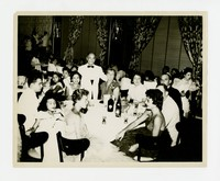 Group at Dinner Party, includes Julie and Lena Panganiban behind, left [Photograph, Black and White] [Notebook 2], circa 1950-1960