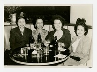 Four Women with Drinks, including Leona Puyot [Photograph, Black and White] [Notebook 2], circa 1950-1960