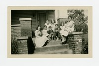 Family on Steps of House without Man [Photograph, Black and White] [Notebook 2], circa 1940-1960