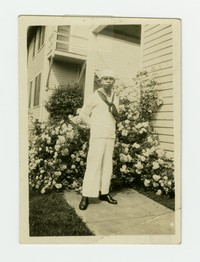 Felipe Mondoñedo in Navy uniform in front of a building with flowers in Annapolis, Maryland [Photograph, Black and White] [Box 2, Black Photograph Box], circa 1919