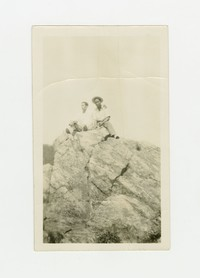 Felipe Mondoñedo (on right) and unknown man sitting on a rock outcropping [Photograph, Black and White] [Box 2, Black Photograph Box], circa 1930