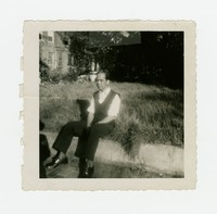 Felipe Mondoñedo sitting on a wall outside a house [Photograph, Black and White] [Box 2, Black Photograph Box], circa 1940-1950
