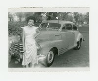 Nita and Mattie's mother around age 20 posing beside a car [Photograph, Black and White] [Box 2, Black Photograph Box], circa 1930-1945
