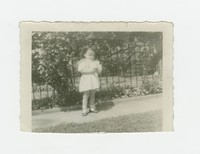 Little girl standing on a sidewalk [Photograph, Black and White] [Box 2, Black Photograph Box], circa 1950
