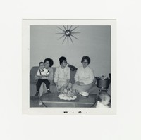 Three women and a little boy on a sofa [Photograph, Black and White] [Box 2, Black Photograph Box], May 1965