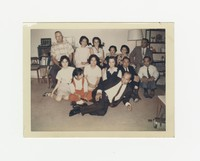 Thirteen people posing for a group portrait with Felipe Mondoñedo lying on the floor [Photograph, Color] [Box 2, Black Photograph Box], circa 1967