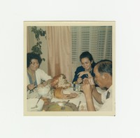 Consuela [?], Nita Mondoñedo and Felipe Mondoñedo eating Christmas dinner [Photograph, Color] [Box 2, Black Photograph Box], December 25, 1965