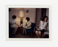 Three women sitting (Nita Mondoñedo on the right) [Photograph, Color] [Box 2, Black Photograph Box], circa 1965-1970