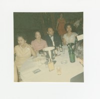 Four people sitting at a table at an event at the Willard Hotel [Photograph, Color] [Box 2, Black Photograph Box], circa 1970